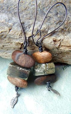 nature stacks pyrite and wood earrings. http://www.etsy.com/listing/89934737/nature-stacks-wood-and-pyrite-earrings