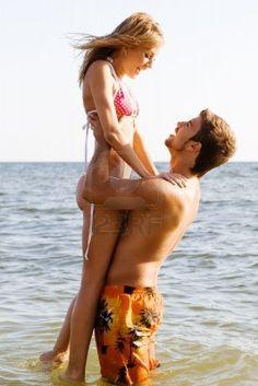 Romantic couple having fun on the seaside Stock Photo