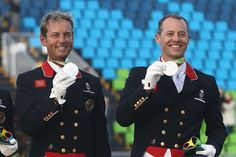 Carl Hester (left) and Spencer Wilton were part of the silver-medal dressage team for Great Britain.