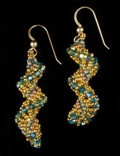 Loving the spiral   Seahorse earrings by Jacqueline Johnson