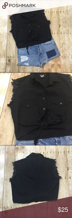 Black frayed edges tie top Super cute the arms holes are frayed and the bottom ties off - excellent used condition no stains or tears Offers are always welcome in my closet, remember to utilize the bundle feature on posh for 2 or more items in my closet and receive 15% off Tops
