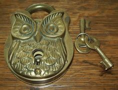 Brass owl working padlock with keys, circa 1896