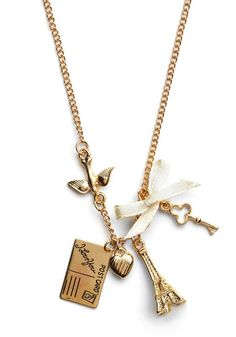 Petite Paris Necklace -- Keep a bit of Paris with you at all times with this too-cute, golden charm necklace.
