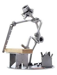 Great looking 'nuts and bolts' metal sculpture in the design of a DIY enthusiast hard at work. Welding Art Projects, Metal Art Projects, Metal Crafts, Welding Classes, Metal Sculpture Artists, Steel Sculpture, Metal Sculptures, Metal Yard Art, Scrap Metal Art
