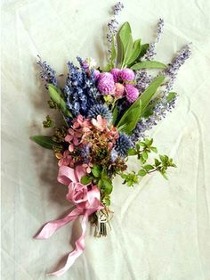 Wildflowers  A mixture of flowers can be just the right look for a country or outdoor afternoon wedding. The stems are quickly bound with florist's tape or a tight circle of raffia, then embellished with a multilooped bow.