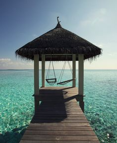 We've saved these seaside hammocks just for you two at @Four Seasons Resorts Maldives. Sharing one is also an option...