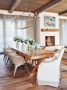 The dining area's large farm table from Clubcu easily accommodates up to 10 people. Floors are reclaimed white oak. - Photo: Jean Allsopp / Design: Georgia Carlee