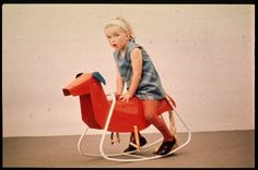 """Prototype rocking toy in the shape of a dog, covered in red PVC and with stove enamelled tubular steel rockers. Prototype de """"cheval"""" à bascule. Apparence d'un chien , pvc rouge. Tube émaillé à chaud. Design: Raymond Wilson, 1968."""