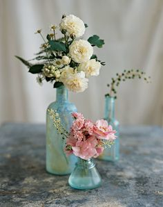 Small, dainty vases put all of the focus on the gorgeous blooms while creating a dreamy feel. Image: Charles Walton