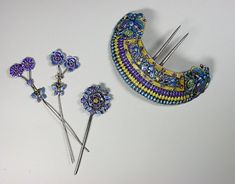 Embossed and enammelled silver comb and hairpins with bright colours. Butterflies and bats motifs. Late Qing Dynasty.