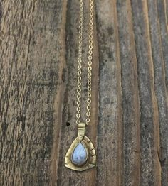 Moonstone Teardrop Necklace   An adornment of the delicate sort, this teardrop necklace disp...   Necklaces