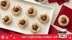 Meet the next stars of your holiday cookie platter! Sugar cookie dough gets rolled in toasty hazelnuts to complement the flavor of the Nutella® hazelnut spread that's dolloped into the thumbprint. Fudge, Cookies Et Biscuits, Sugar Cookies, Crinkle Cookies, Chip Cookies, Pudding, Glass Baking Dish, Cake Recipes, Nutella Recipes