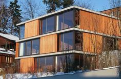 A Contemporary Style: Lots of light, wood, floor-to-ceiling windows