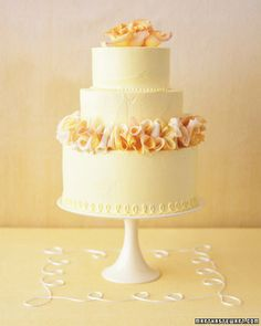 Ruffly Rose-Petal Garland     A string of soft petals encircling a dainty cake makes romantic use of a classic flower. Lemon curd fills butter-cake layers, which are frosted in white-chocolate buttercream that has been tinted yellow.      Read more at Marthastewartweddings.com: A Slice of Heaven
