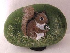 Hand painted rock-art-paintings-squirrel w/flower-Martha Winenger (01/20/2013)