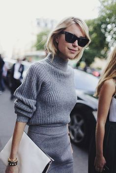 grey jumper, white clutch, shades