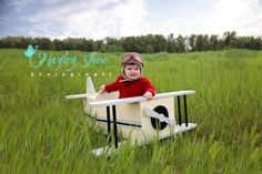 Calgary airplane mini sessions!  How cute is this little man!!  Toddler boy photo session, baby boy photo session, 1 year old photo ideas.