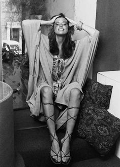 Carly Simon in knee-high gladiators; photographed by Jack Robinson, circa 1971