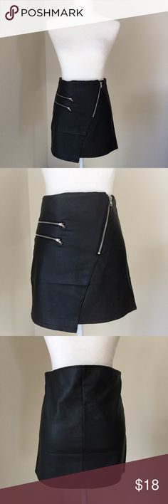 Vegan Leather Skirt Black faux leather skirt. Slightly asymmetrical in the front with silver toned zippers and a button. Soft to the touch. Rue 21 Skirts Mini