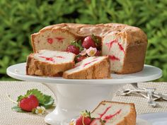 Strawberry Swirl Cream Cheese Pound Cake Recipe | This reader recipe is not only a moist, crowd-pleasing pound cake – it's also got a beautifully swirled presentation. Pound cakes are a classic Southern dessert that find their way onto tables of all occasions. A thick slice is the perfect way to welcome new neighbors, cheer up a friend, or feed a crowd at the church potluck, and you won't need to worry about frosting cake layers or transporting a delicate dessert.