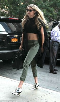 Gigi Hadid shows off taut tumm as she and Joe Jonas step out in NYC #dailymail