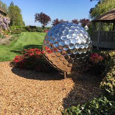 Allison recently designed a custom Golf Ball stainless steel sculpture for an exquisite garden in Canterbury, UK. Enchanted with how it reflects the magical colors of the garden! Order yours today: allisonarmour.com #sculpture #gardensculpture #golfball #golfballsculpture #landscapedesign #gardendesign #gardenart Steel Sculpture, Modern Sculpture, Garden Sculpture, Garden Art, Garden Design, Golf Ball, Landscape Design, Fountain, Modern Design