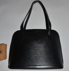 Authentic Louis Vuitton Epi leather Lussac in black with the original dust bag.   Epi leather is with a couple of very fine and tiny scratches if very closely examined but otherwise, it is clean. Epi leather on the bottom corners is with small amount of light scratches. Epi leather on the bottom is without marks or wear. Ep leather straps are firm without marks or wear. Lining is with a few small marks. Golden zipper pulls are very shiny with small amount of loss of the golden plating on…