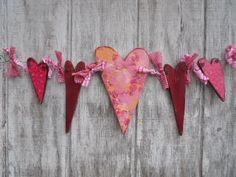 Love the look of these Valentine hearts.  It's decoupaged wood - or for a simpler version, just use scrapbook paper