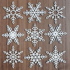 Set of 9 Wood Snowflakes with Hanging Twine, Wooden Christmas Ornaments - Set of 9 unique unfinished wooden snowflakes for your holiday, Christmas, and winter decor! Wooden Christmas Ornaments, Red Christmas, Christmas Crafts, Christmas Decorations, Holiday Decor, Hanging Ornaments, Wood Snowflake, Snowflake Ornaments, Snowflakes
