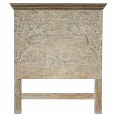 """Showcasing hand-carved detailing and a weathered lime wash, this mango wood headboard adds a vintage-inspired touch to your master suite or guest room.  Product: HeadboardConstruction Material: Mango woodColor: Lime washFeatures:  Hand-carvedWeathered detailing Dimensions: Queen: 62"""" H x 71"""" W x 3"""" DCalifornia King: 62"""" H x 83"""" W x 4"""" DNote:This product is for headboard only. Picture shows the full bed for illustration purposes only."""