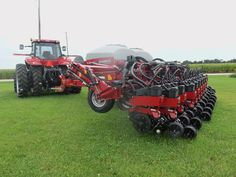 CaseIH 1245 corn planter hooked to Magnum 290