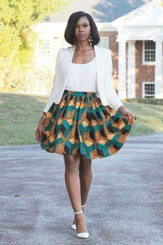 Imani knee length skirt in Ankara print.  Yes, it has pockets!!