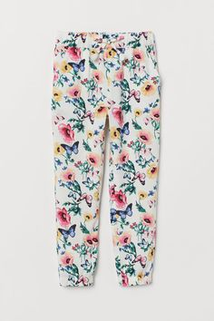Joggers in airy, woven viscose fabric. Elasticized waistband and drawstring with tassels, side pockets, and tapered legs with covered elastic at hems. World Of Fashion, Fashion News, Kids Fashion, Cuties Diapers, Weather Wear, Fall Weather, Floral Leggings, Viscose Fabric, Girls Accessories