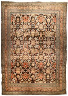A late 19th century Persian Tabriz antique rug, the midnight field with a bold trellis overall of angular vines, abstract palmettes and split leaves within a narrow red palmette border. Watch full size video of A Persian Tabriz rug, Circa 1880, ID BB4493 - Video