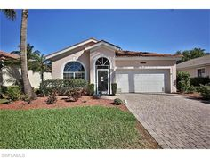 "Welcome Home.. to this beautiful three bedroom, two bath, plus den villa in Reflection Lakes. This highly sought after Pool home welcomes you when entering with a formal dining space that has new hardwood flooring. Making your way into the kitchen, you will find new stainless appliances, 42"" cabinets, pantry, and an eat-in area which opens up into the spacious great room. Tons of natural light and tile throughout the common areas which all overlook the lanai and Pool."
