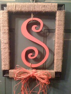 """Red S picture frame """"wreath"""" door hanger - used a dollar store frame, jute, red raffia and a letter from Hobby Lobby painted Cardinal Red."""