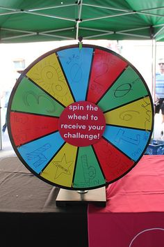 spin the wheel science challenge - outdoor science busking activity