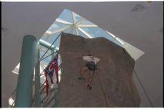 Ohio University Ping Center opening, climber on rock climbing wall, 1996 :: Ohio University Archives