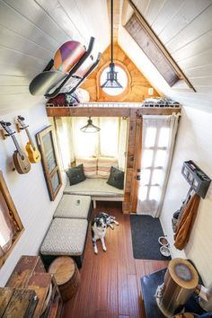 Cushions on moveable boxes/ottomans. Flexible plan! Op: Couple Quits Day Jobs, Builds Quaint, Tiny Home On Wheels To Travel The Country