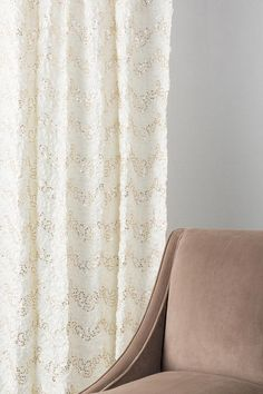 The Ivory & Gold Sequin Window Panel features a unique zig-zag pattern of ribbon embroidery and gold sequins to create a classic & feminine look. The rod pockets fit easily onto curtain rods to quickly add a special touch to your apartment or home. Pair with our additional home textiles & home decor options for a complete look!