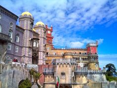 Palace of Pena - The Cultural Landscape of Sintra, Portugal: A Comprehensive Guide | via Viator.com  Sintra, a UNESCO World Heritage Site, is lined with colorful houses, perfumed by lilacs and wisterias in their back gardens, whitewashed streets replete with souvenir shops and a selection of restaurants, which make it a good base for exploring the palaces. Sintra, Lisbon Region, Portugal
