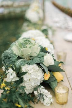 One more shot of this Cabbage Centerpiece -- up close & personal. Just love it!  See the wedding here: http://www.StyleMePretty.com/2014/05/28/autumn-wedding-in-door-county/ Floral Design: EbbAndFlowFlower.com -- Photography: EmilySteffen.com