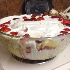 Angel food cake truffle... Angel food cake, 2 packages of banana cream pudding, strawberries, bananas and whip cream. Delish and so easy!