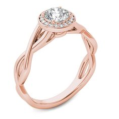 Honor the one you love with a diamond engagement ring that's both classic and modern. Fashioned in precious 14K rose gold, this ring showcases a 3/8 ct. round diamond center stone. A border of smaller round accent diamonds surrounds the center stone, while the gracefully twisting shank completes the design. A look she'll treasure, this engagement ring captivates with 1/2 ct. t.w. of diamonds and a polished shine.