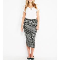 "NWT daisy midi skirt with silt Soft knit body, thin material. Two side slits with a stretchy fit. 29"" length rayon/spandex. Skirts Midi"