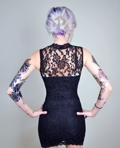 Between the dress, hair, and tattoos, this is pretty awesome!!