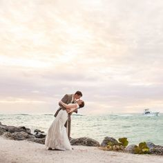 Linneah and Pete's tropical destination beach wedding was simply elegant. They married at the Fort Zachary Taylor State Park.