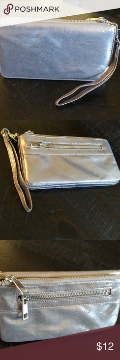 Buckle Silver Clutch Wallet Small silver metallic clutch wallet. New/Never used. Pretty iridescent wallet that fits 12 cards plus Clear photo ID pocket and button closure. Has 2 zipper pockets and 1 large pocket in the back. Has wristlet attached. Cute going out clutch when you don't want to bring a purse. Buckle Bags Clutches & Wristlets
