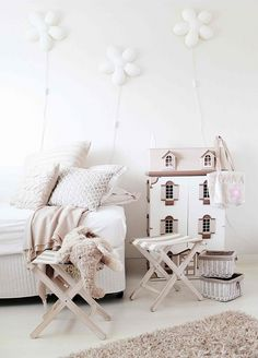 Flowers on the wall. the folding chairs, doll house... Just love