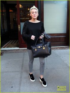 Miley Cyrus carrying Versace Signature Bag $2675.